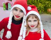 Christmas santa costumer kid girls portrait smiling — Stock Photo