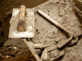 Cement mortar dirty tools like trowel — Stock Photo