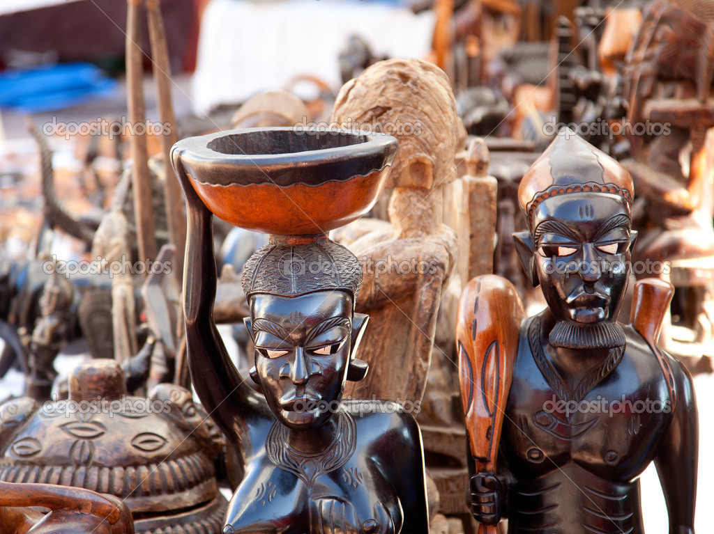 African handcraft dark wood carved figures — Stock Photo #10582951