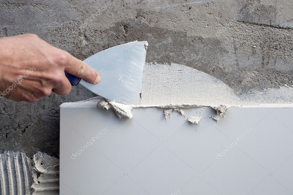 Construction spatula trowel in tile work with white mortar — Stock Photo #10582967