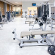 Fitness club gym with sport equipment interior — Stock Photo #8510359
