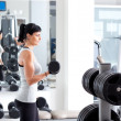 Woman with weight training equipment on sport gym — Stockfoto