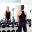 Man with dumbbell weight training equipment  gym - Stock Photo