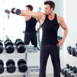 图库照片: Man with weight training equipment on sport gym