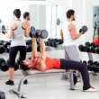 Foto Stock: Group of in sport fitness gym weight training