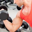 man met gewicht trainingsapparatuur op sport gym — Stockfoto