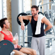 Two men on a sport gym relaxed after fitness — Stock Photo