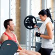 Foto Stock: Man and woman friends on sport gym relaxed