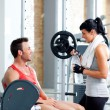 图库照片: Man and woman friends on sport gym relaxed