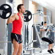 Man with dumbbell weight training equipment gym — Stock Photo