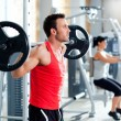 Stock Photo: Man with dumbbell weight training equipment gym