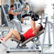 Group with weight training equipment on sport gym - Stock Photo