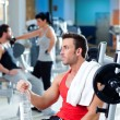 图库照片: Man relaxed on gym after fitness sport training