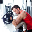 Man with weight training equipment on sport gym — Stock Photo #8511318