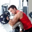 Stock Photo: Man with weight training equipment on sport gym