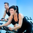 Stationary spinning bicycles fitness girl in a gym — Стоковое фото