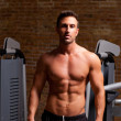 Fitness shaped muscle man posing on gym - Stock Photo