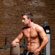 Fitness shaped muscle man posing on gym — Stock Photo #8511446