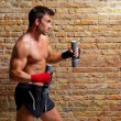 Muscle boxer man with fist bandage and weights — Stock Photo