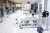 Fitness club gym with sport equipment interior — Stock Photo