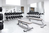 Fitness club weight training equipment gym — Stock Photo