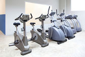 Elliptical cross trainer, stationary bicycle treadmill — Stock Photo