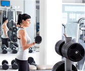 Woman with weight training equipment on sport gym — Stock Photo