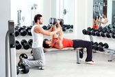 Gym personal trainer man with weight training — Stockfoto