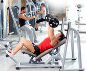 Group with weight training equipment on sport gym — Stock Photo