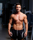 Fitness shaped muscle man posing on gym — Stock Photo