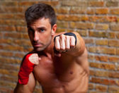 Muscle boxer shaped man fist to camera — Foto de Stock
