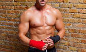 Muscle boxer shaped man with fist bandage — Stock Photo