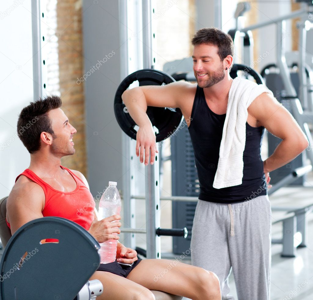 Two men on a sport gym relaxed after fitness stock photo for Gimnasio sport gym