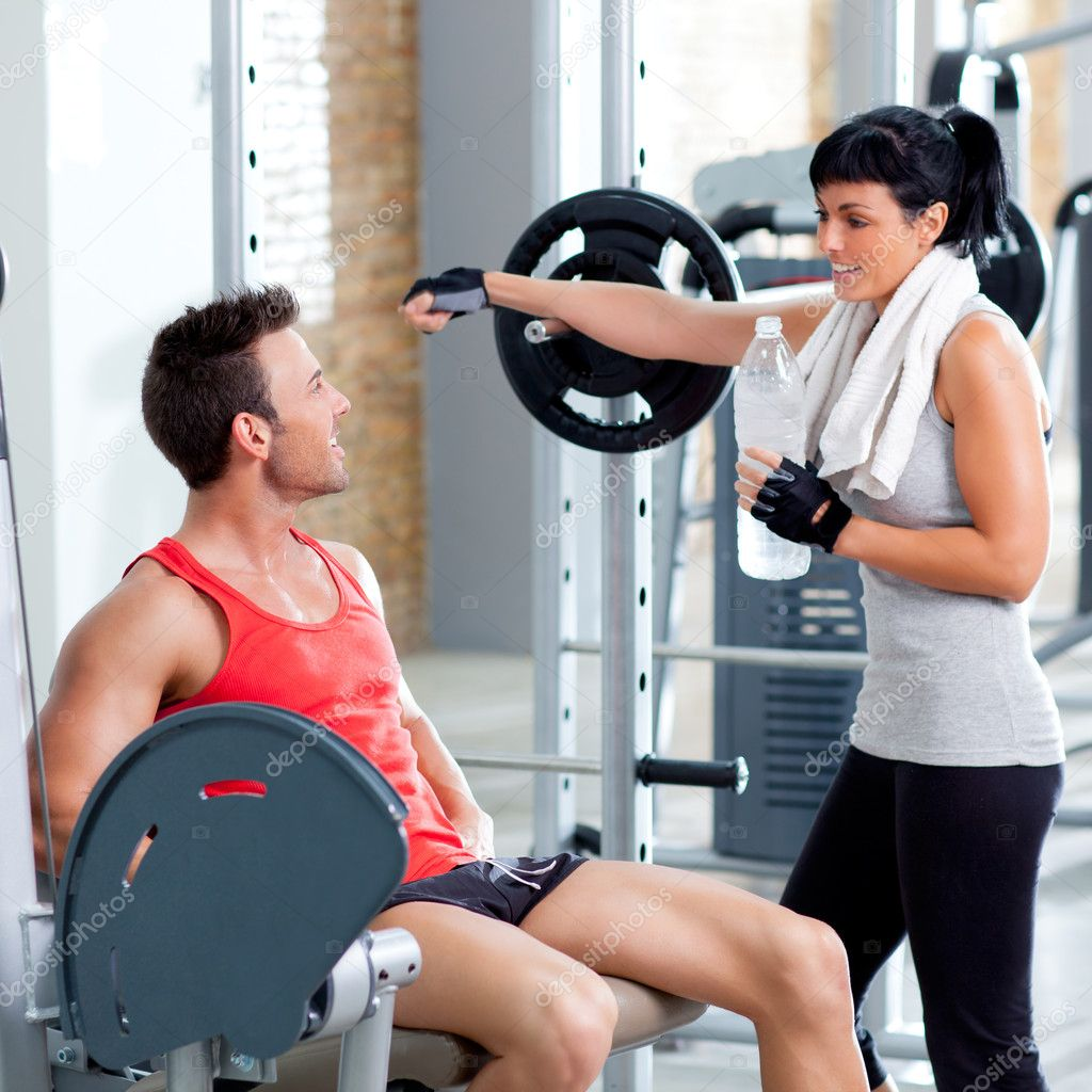 Man and woman friends on sport gym relaxed stock photo for Gimnasio sport gym