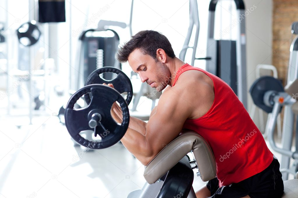 Man with weight training equipment on sport gym club — Stock Photo #8511318