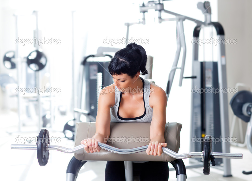 Woman with weight training equipment on sport gym club — Lizenzfreies Foto #8511346