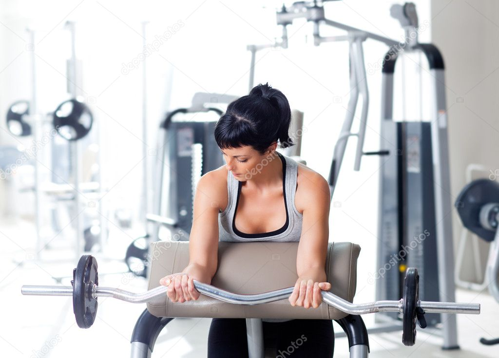 Woman with weight training equipment on sport gym club — Zdjęcie stockowe #8511346
