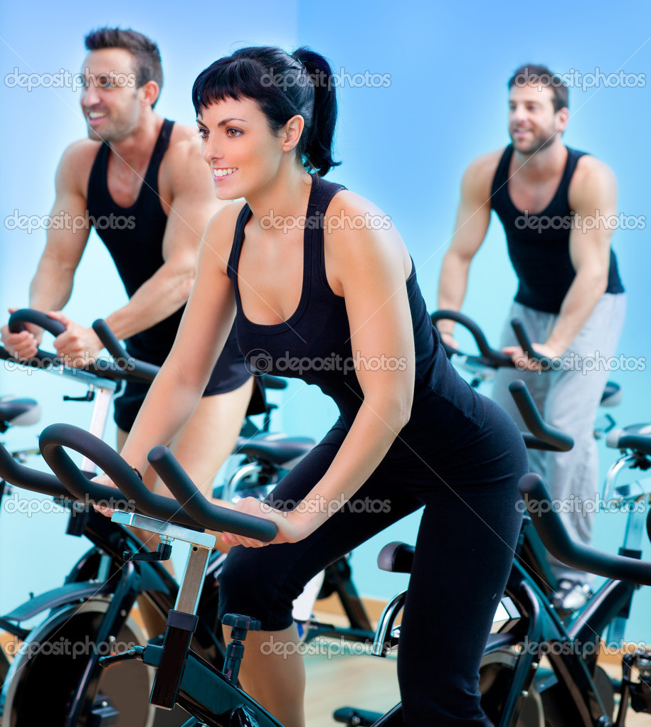 Stationary spinning bicycles fitness girl in a gym sport club  Stock Photo #8511385