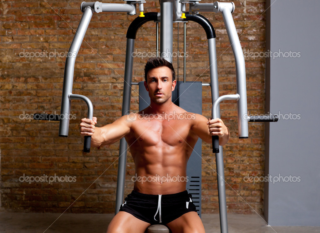 Muscle shaped man exercise on sport gym fitness club in brick wall  Stock Photo #8511521