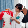 Dressmaker with mannequin working at home — Stock Photo