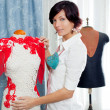 Dressmaker with mannequin working at home - Foto Stock
