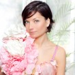 Beautiful flowers woman with spring pink dress — Stock Photo