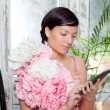 Fashion woman and tablet ebook reading with flowers dress — Stock Photo
