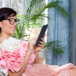 Fashion woman and tablet ebook reading with flowers dress — Stock Photo #8700062