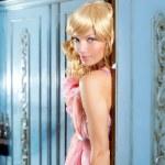 Blond fashion woman vintage in wardrobe pink dress — Stock Photo #8700147