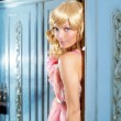 Blond fashion woman vintage in wardrobe pink dress — Stock Photo