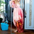 Stock Photo: Fashion vintage blond housewife cleaning mop chores