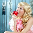 Royalty-Free Stock Photo: Blond fashion princess eating apple with flowers dress