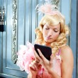 Blond fashion princess woman reading ebook tablet - Stock Photo