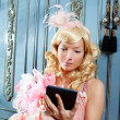 Blond fashion princess woman reading ebook tablet — Stock Photo #8700507